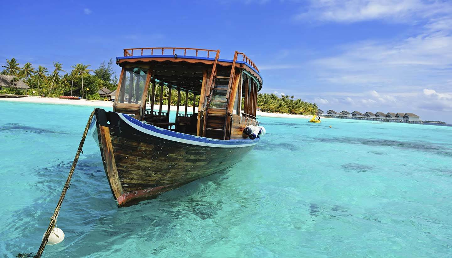 Maldivas - Wooden Dhoni Boat on the shore of the Maldives