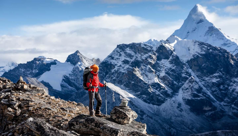 Nepal - Hiker posing on trek in Himalayas, Nepal