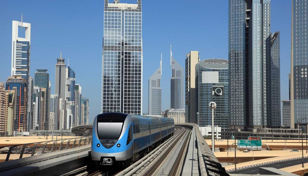 Dubai - Metro train downtown in Dubai, UAE.
