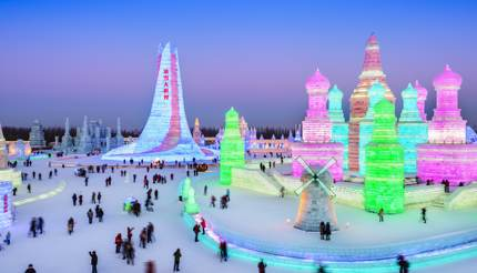 China - People admiring colourful lights in the ice buildings