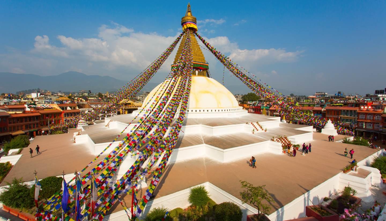 Nepal - People dotted around the Boudhanath stupa in Kathmandu