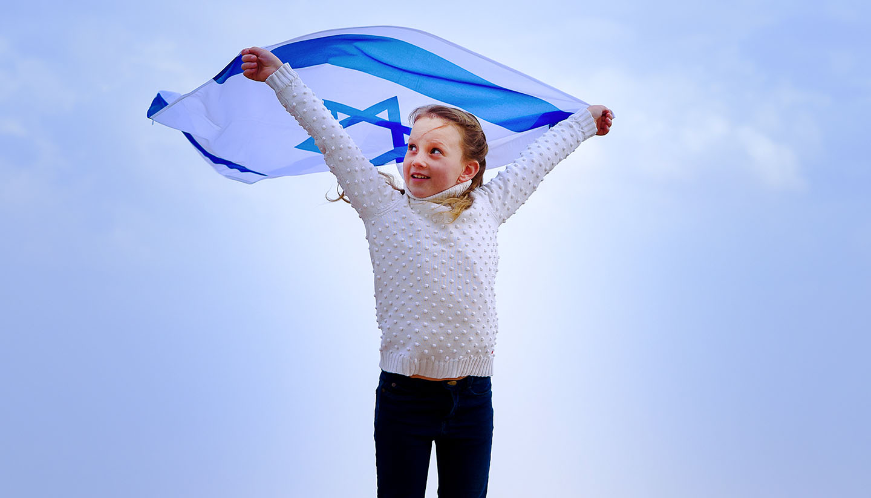 Israel - Girl holding Israel flag