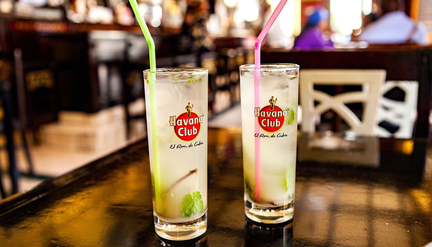 Cuba - Two glasses of Havana Club with mint leaves and a straw each